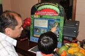 Touch-screen IPM kiosk used in outreach to Spanish-speaking audiences. Photo by K. Windbiel-Rojas.
