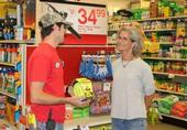 Retailer speaking with customer