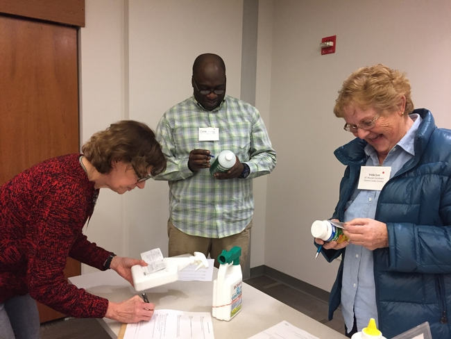 Attendees learn how to read pesticide labels during a hands-on exercise. [A. Schellman]