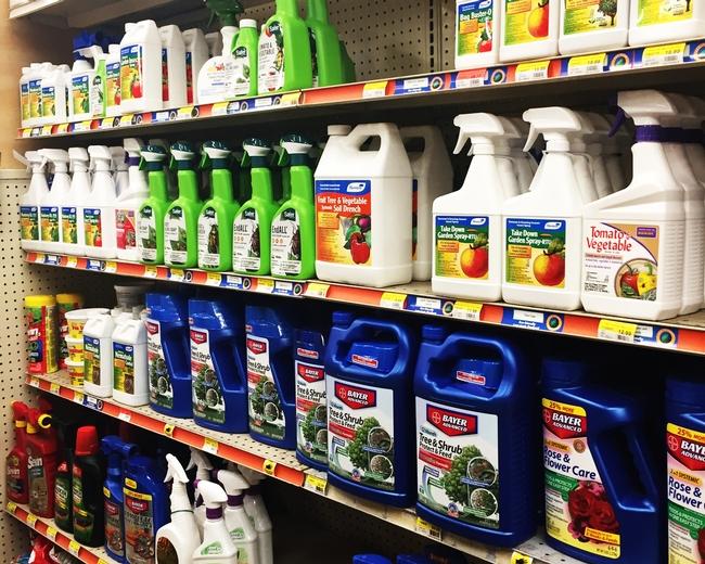Pesticides on shelf. (Credit: Anne Schellman) for Pests in the Urban Landscape Blog