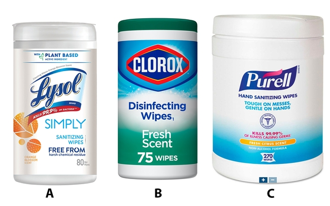 Three containers of different types of sanitizing and disinfecting wipes.