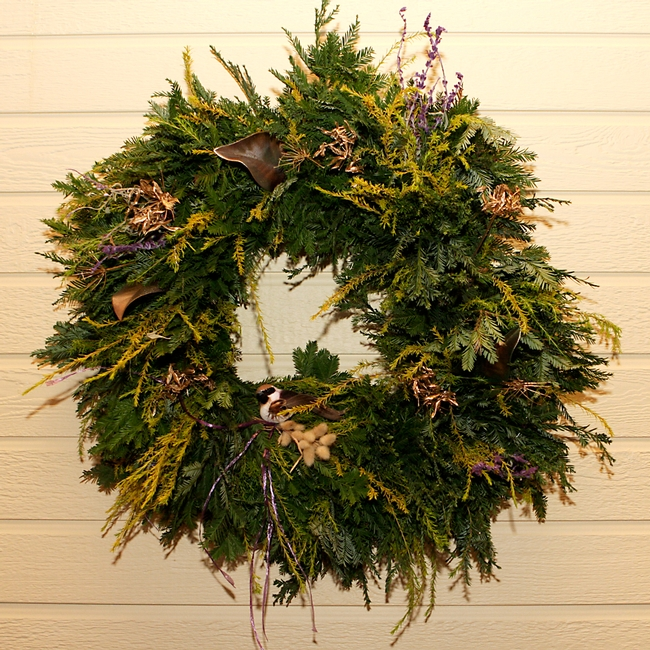 A wreath with breath of heaven, redwood and sage.