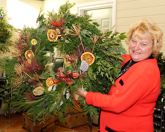 A wreath maker with her finished product.