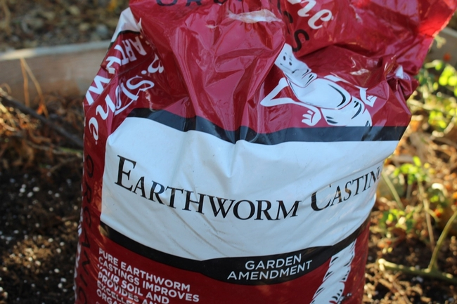 a red bag of worm castings aka worm poo