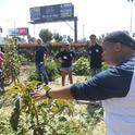 Urban farmer Mia talks about crops at the Community Services Unlimited Expo Farm in South Los Angeles.