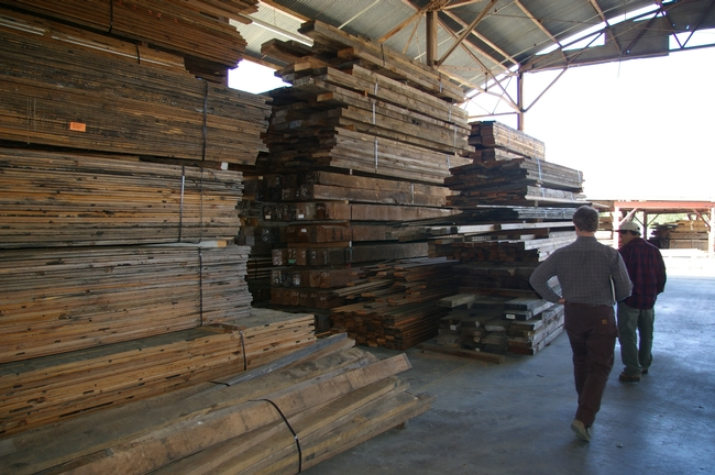 Tad Mason & Marc Mandel look at the inventory of reclaimed lumber