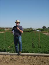 Dan Putnam discusses the importance of variety selection at an alfalfa field day.