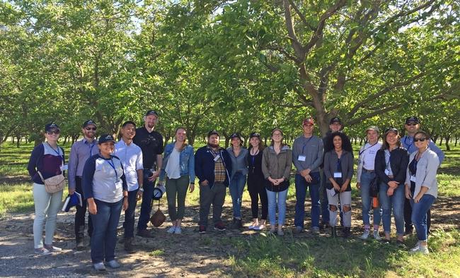 Morada Produce usa agua de desecho de la planta de procesamiento de cerezas para regar estos nogales, menciono Scott Brown (quinto de izquierda a derecha).