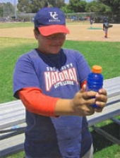 A boy with a sports drink.