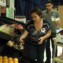 Terri Spezzano loads fresh fruit and vegetables in an afterschool 'farmers market' in Turlock.
