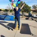 Nancy Caywood-Robertson jumps off a bale of hay at the UC Desert Research and Extension Center 'Farm Smart' celebration.