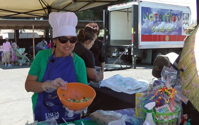 UCCE nutrition educator Grilda Gomez provides nutrition education at FoodLink of Tulare County fresh produce giveaway in Farmersville.