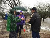 From left, UC Davis plant sciences professor Ken Shackel speaks with research project partners UC Davis professor Helen Dahlke (in the purple jacket) and Roger Duncan, UC ANR Cooperative Extension advisor, at the flooding site.