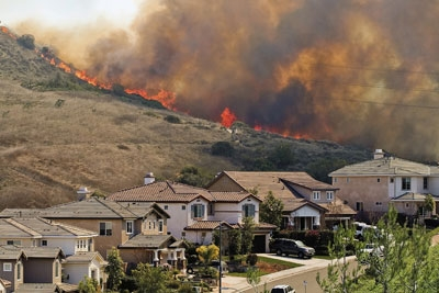 Wildfire threatening a California subdivision.