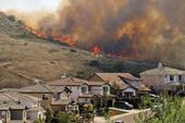 Wildfire threatening a California subdivision.