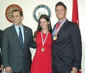 Sissy and Samuel Sugarman pose with Congressman Darrell Issa after receiving their medals.