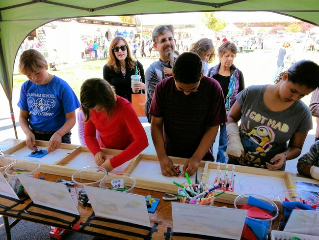 Youth experiment at a 4-H Junk Drawer Robotics booth at Bay Area Science Festival Discovery Day. (Photo: Sonoma County 4-H)