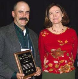 Dan Macon, with Shermain Hardesty of the Small Farm Program, receives the Pedro Ilic Award.