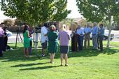 The news media gather for a press conference with Rep. Jim Costa, UC mosquito researcher Anthony Cornel, and other officials.