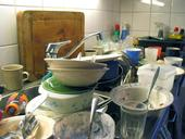 UC researcher Mark Lubell uses dirty dishes in a shared kitchen as an example of how one person's decisions impacts others.