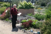Rose Hayden-Smith in front of a demonstration Victory Garden.