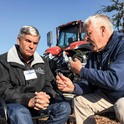 Alan Wilcox, left, and Jeff Mitchell debate the challenges and opportunities for conservation tillage. (Photo by Farm Equipment magazine, used with permission)