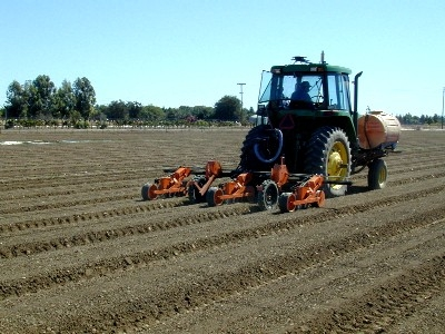In an example of Upadhyaya's precision agriculture work, a GPS-based auto-guidance system is being used to plant tomato seeds using a vacuum planter on the same beds in which tomatoes were transplanted previously.