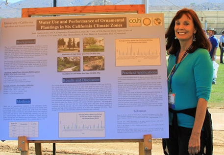 UCCE advisor Janet Hartin with a research poster on plant water use and climate zones.