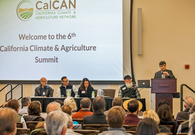 UCCE specialist Tapan Pathak addresses the audience at the CalCAN Summit.