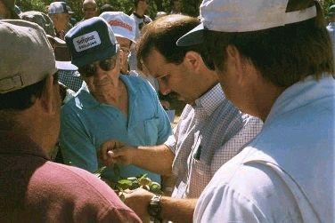 UC farm advisor Roger Duncan, center, with a group of California farmers.