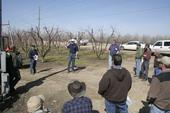 Farm advisors introduce peach producers to new thinning technology.