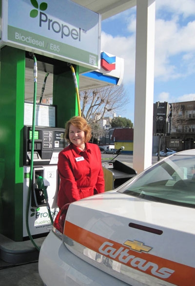 USDA's Judith Canales fuels a CalTrans vehicle that runs on biofuel.