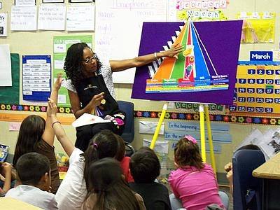 Diane King speaks to students at Romoland Elementary School.