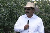 Manuel Jimenez speaks at a recent blueberry field day.