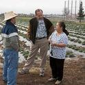 Richard Molinar, center, and his assistant Michael Yang, left, with a local farmer.