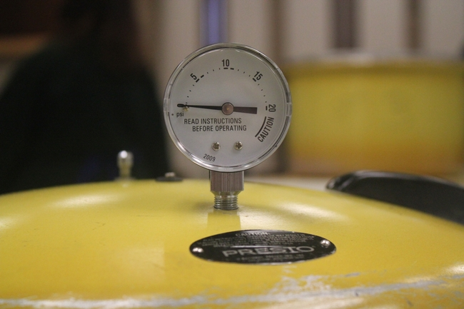 Pressure gauge on canner lid.