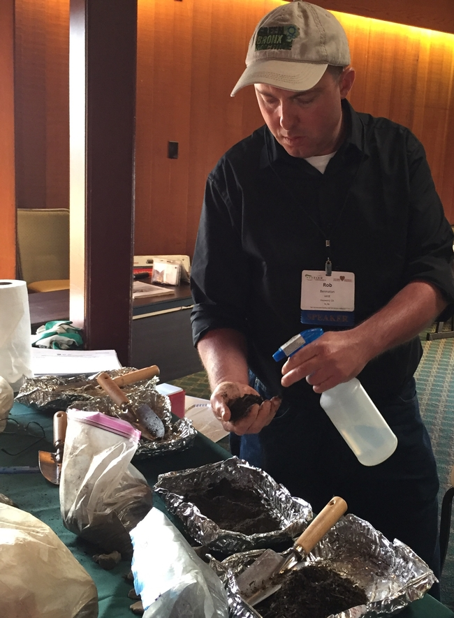 Rob Bennaton showed participants how to evaluate soil structure and advised them to test soil for contaminants before planting food crops.