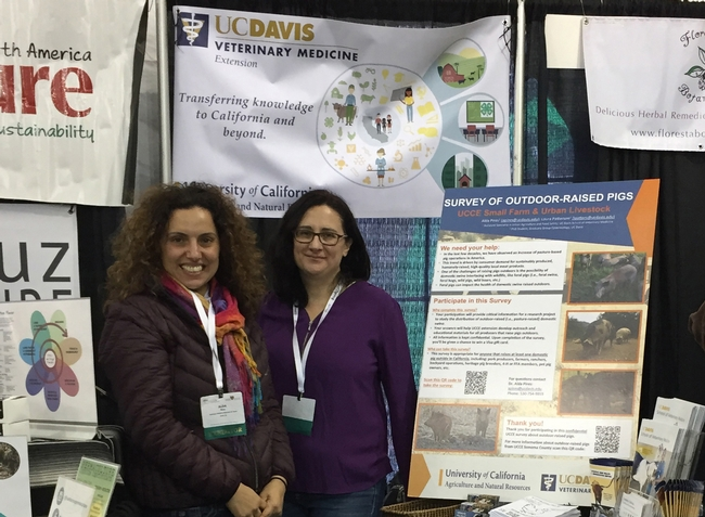 Alda Pires and Laura Patterson talked to people about raising pigs and chickens.