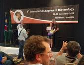 Professor Thomas Pape of the Natural History Museum of Denmark and chair of the Council for the International Congresses of Dipterology, presents the top student prize to Jessica Gillung. The next Congress takes place in 2022 in California