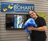 Bohart associate Emma Cluff cuddles a tardigrade, one of the stuffed animals available for sale in the Bohart Museum of Entomology's gift shop. (Photo by Kathy Keatley Garvey)