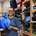 Entomologist Eliza Litsey, who received her bachelor's degree in entomology this year from UC Davis, shows some of the water bears (tardigrades) available in the Bohart Museum of Entomology gift shop. (Photo by Kathy Keatley Garvey)