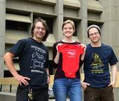 EGSA members and their award-winning t-shirts: president Brendon Boudinot; EGSA t-shirt coordinator Jill Oberski; and Corwin Parker. (Photo by Kathy Keatley Garvey)