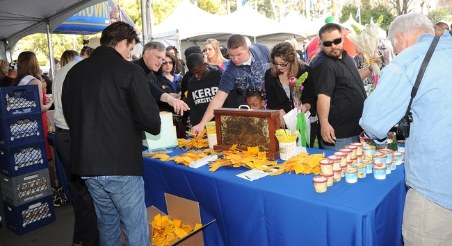 Crowd filters into the California Ag Day celebration. This is the California State Beekeepers' Association booth. (Photo y Kathy Keatley Garvey)