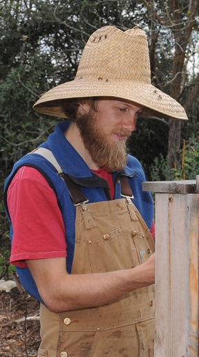 Derek Downey working in the Davis Bee Sanctuary. (Photo by Kathy Keatley Garvey)