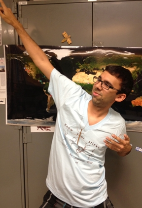Entomology major Joel Hernandez strikes a walking stick pose. (Photo by Fran Keller)