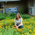 Beekeeper Elizabeth Frost in front of the pollinator patch she planted. (Photo by Kathy Keatley Garvey)