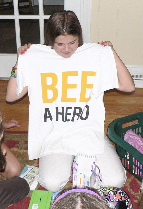BEE CRUSADER--Hannah Fisher Gray, 11, of Wilmington, Del., asked her birthday guests to donate to the honey bee research fund instead of giving presents to her. She collected $110, and then matched the funds so she could give $110 to UC Davis and $110 to Pennyslvania State. One of her friends gave her this t-shirt.
