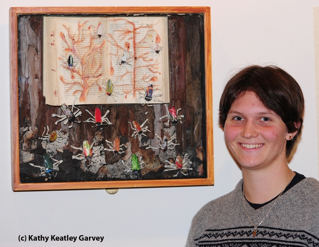 Whitney Krupp with her beetle art work. (Photo by Kathy Keatley Garvey)
