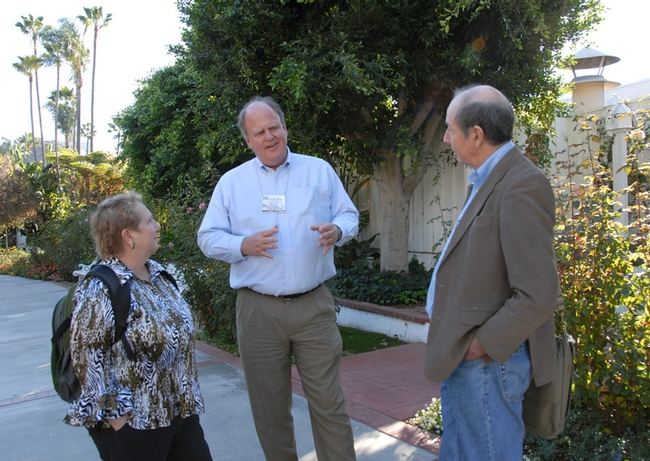 Kelli Hoover of Penn State chats with Kevin Heinz (center) of Texas A&M and Bruce Hammock of UC Davis at a meeting of the Entomological Society of America. (Photo by Kathy Keatley Garvey)