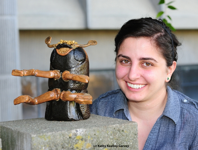 Kristina Tatiossian and the ceramic mosaic of a walnut twig beetle. (Photo by Kathy Keatley Garvey)
